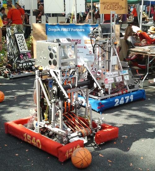 Omsi makers fair robots playing basketball
